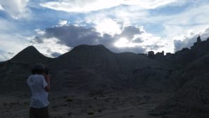 Kilor photographing rock formations against a gorgeous sky near Fantasy Canyon.