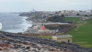View from Castillo San Felipe del Morro, Puerto Rico. In the far distance, Condado; in the middle, La Perla.