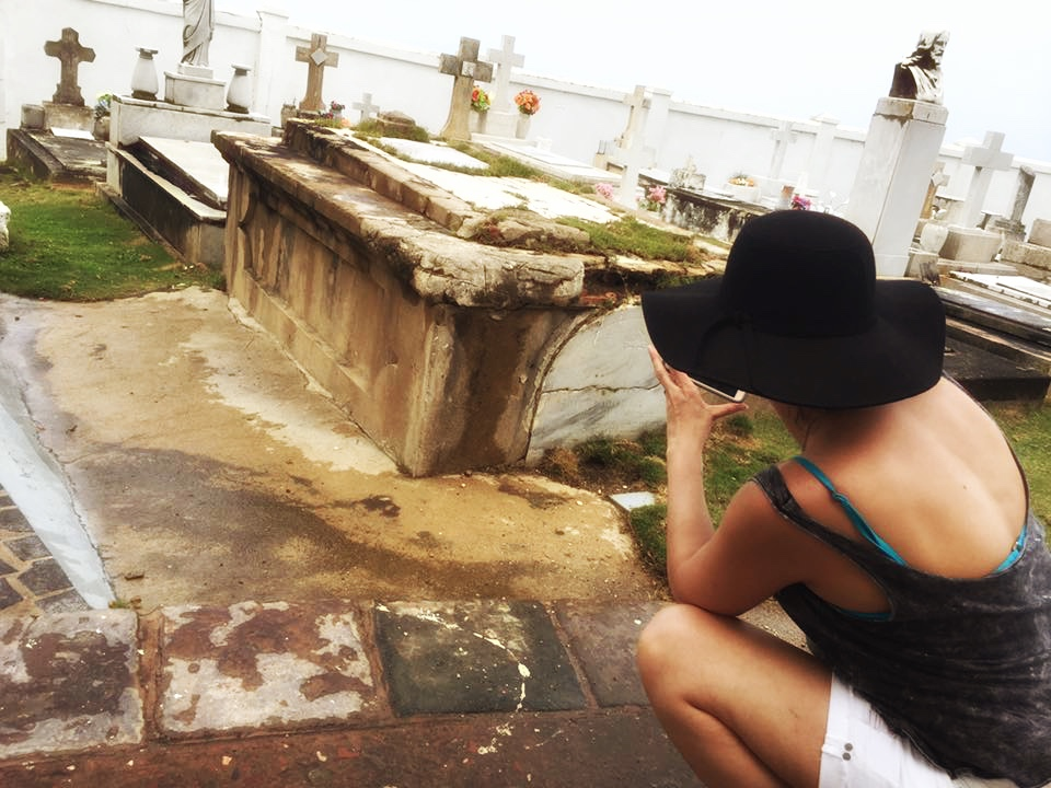 Marcy photographing an old, above ground gravs in Santa Maria Magdalena de Pazzis Cemetery, Puerto Rico