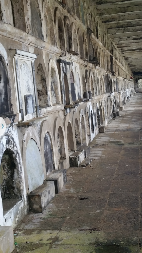 Decaying structure of above ground graves in Santa Maria Magdalena de Pazzis Cemetery, Puerto Rico