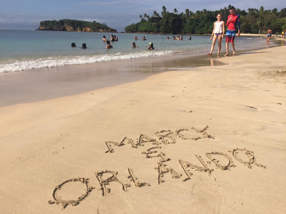 "Writing in sand that reads ""Marcy & Orlando"" on Cerro Gordo Beach, Vega Alta Puerto Rico"
