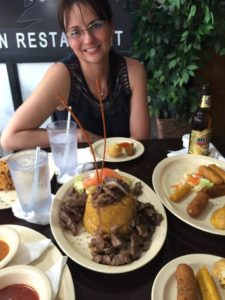 Marcy eating mofongo at Cafe del Angel Puertorican Restaurant Condado, Puerto Rico