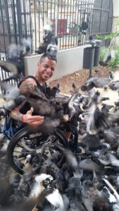 Orlando surrounded by pigeons at Pigeon Park, Old San Juan, Puerto Rico