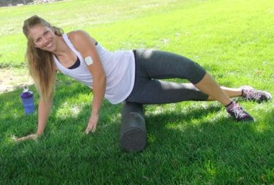 How to foam roll correctly. This photo has Shae demonstrating foam rolling.