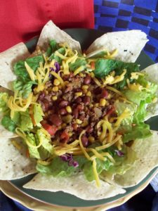 Family Friendly Taco Soup Served with Salad and Tortilla Chips